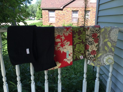 "Left to right: Black Fleece Hotsling size 3 Black Cotton Hotsling Size 4 OhSoSara Pouch in Red and Khaki floral- 52"" Peanut Shell Pouch in Green and Brown floral- 52"" Mamma's Milk Adjustable Pouch in Skull and Rose print- M/L WAHM Grey Floral pouch- 49"" All pouches are a $25 deposit."